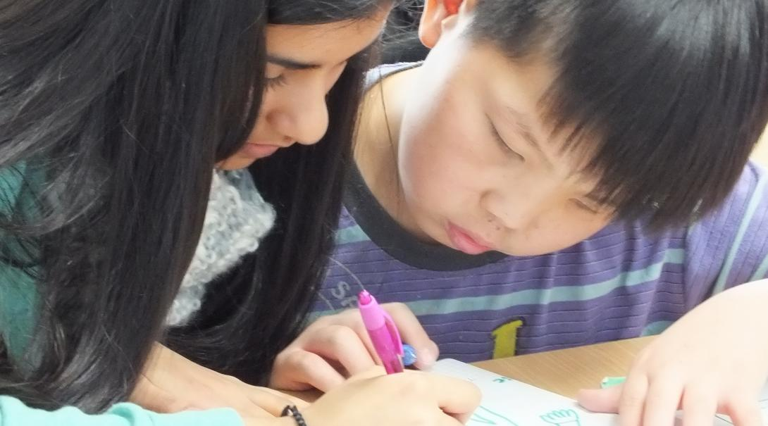 An intern working with a child during her Social Work internship in Mongolia